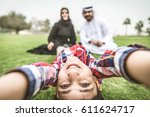 arabic family playing with child | Shutterstock . vector #611624717