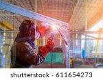 worker welder man welding angle ... | Shutterstock . vector #611654273