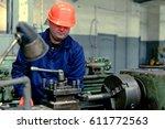 worker in factory on the machine | Shutterstock . vector #611772563