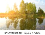 dawn on the lake | Shutterstock . vector #611777303