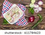 sliced herring fillets  cut...   Shutterstock . vector #611784623
