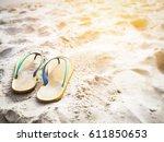 flip flops sandals on the sandy ... | Shutterstock . vector #611850653