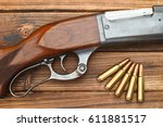 lever action rifle and bullets... | Shutterstock . vector #611881517
