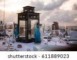 beach front dinner | Shutterstock . vector #611889023