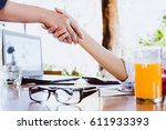 two businesswoman having... | Shutterstock . vector #611933393