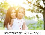 mother and child are hugging... | Shutterstock . vector #611962793
