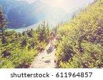 hiking man in canadian... | Shutterstock . vector #611964857