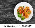 delicious portion of golden... | Shutterstock . vector #612061397