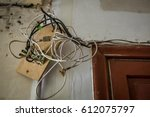 wires hanging from ceiling in... | Shutterstock . vector #612075797