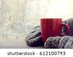 red mug of hot drink with a... | Shutterstock . vector #612100793