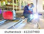 welder is working at the... | Shutterstock . vector #612107483
