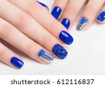 beautifil blue manicure with... | Shutterstock . vector #612116837
