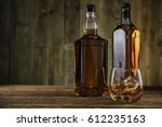 whiskey on the rock on old wood ... | Shutterstock . vector #612235163