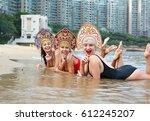 three young girls in a bikini... | Shutterstock . vector #612245207