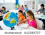 geography lesson at school | Shutterstock . vector #612283727