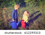 little boy and girl working in... | Shutterstock . vector #612295313