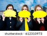 three beautiful girls stand on... | Shutterstock . vector #612310973