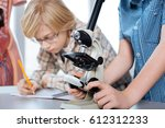careful focused young scientist ... | Shutterstock . vector #612312233