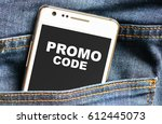 Small photo of Promo code inscription on phone screen / Smartphone in front jeans pocket with Promo code inscription