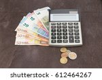 banknotes and coins with... | Shutterstock . vector #612464267