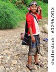 Small photo of Pak Nam Noy, Laos-October 8, 2015: The Akha Ya-Er hill tribe are an ethnic minority living in the area between E.Myanmar-N.Thailand-W.Laos-S.China. Woman waits to cross by row-boat the Nam Phak river.