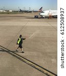 Small photo of DALLAS, USA - MAR 30, 2017: DFW international airport with American Airlines Aircraft carrier signal man