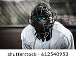 umpire in face mask  behind...   Shutterstock . vector #612540953