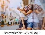 two beautiful girls playing...   Shutterstock . vector #612605513