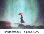 woman with an umbrella standing ... | Shutterstock . vector #612667697