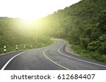 empty curved road blue sky and