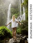beautiful woman and waterfall. | Shutterstock . vector #612722543