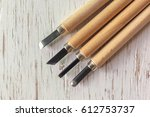 close up carving tool on rustic ... | Shutterstock . vector #612753737