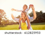 cheerful mom holding daughter... | Shutterstock . vector #612825953