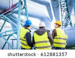 engineers discussing... | Shutterstock . vector #612881357