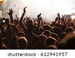 crowd at concert   summer music ... | Shutterstock . vector #612941957
