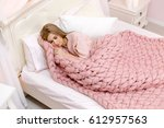 young woman sleeping in bed...   Shutterstock . vector #612957563