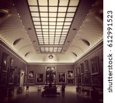 Small photo of London, England, UK - 14 July 2015: Interior of the Wallace Collection in Hertford House at Manchester Square, Marylebone, London. Long gallery lined with paintings and cove ceiling. Sepia toned.