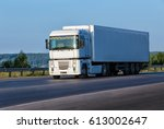 big white truck goes on highway | Shutterstock . vector #613002647