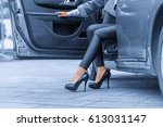 young lady get out of the car | Shutterstock . vector #613031147