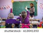 school children are... | Shutterstock . vector #613041353
