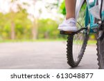 ride a bicycle in the park with ... | Shutterstock . vector #613048877