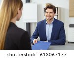 smiling young man attending a... | Shutterstock . vector #613067177