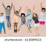diverse group of kids jumping... | Shutterstock . vector #613089023