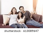 young asian family watching tv... | Shutterstock . vector #613089647