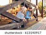 Two Little Girls Plays Near Th...