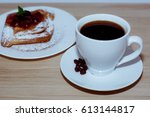 Small photo of Fresh aFresh and tasty croissants with chocolate and cup of coffee