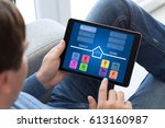 man in jeans holding tablet... | Shutterstock . vector #613160987