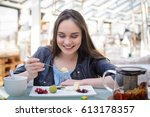 beautiful girl in a cafe... | Shutterstock . vector #613178357