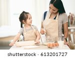 mother and daughter using a...   Shutterstock . vector #613201727