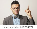 smiling young man  pointing... | Shutterstock . vector #613233377